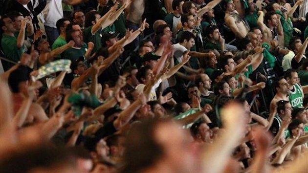 Fans of Panathinaikos Athens at a basketball match (Reuters)