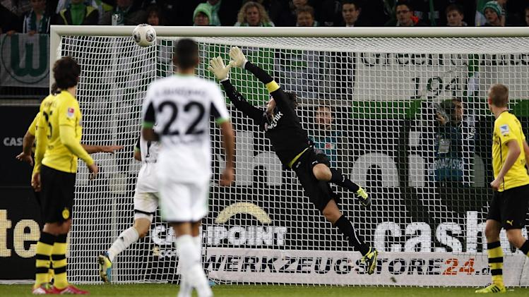 Dortmund goalkeeper Roman Weidenfeller receives Wolfsburg's second goal scored by Ivica Olic of Croatia during the German first division Bundesliga soccer match between VfL Wolfsburg and Borussia Dortmund in Wolfsburg, Germany, Saturday, Nov. 9, 2013