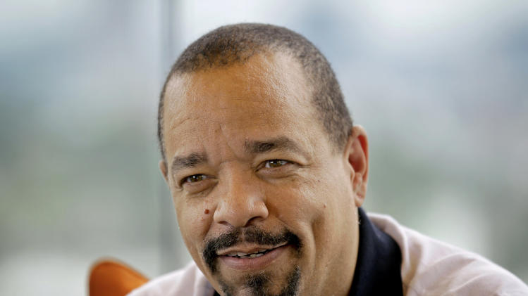 "This June 11, 2012 photo shows rapper and actor Ice-T in Atlanta. Ice-T wants to show the importance of lyricism in rap music through his new documentary, ""Something From Nothing: The Art of Hip-Hop,"" which premieres in 150 theaters on Friday. (AP Photo/David Goldman)"