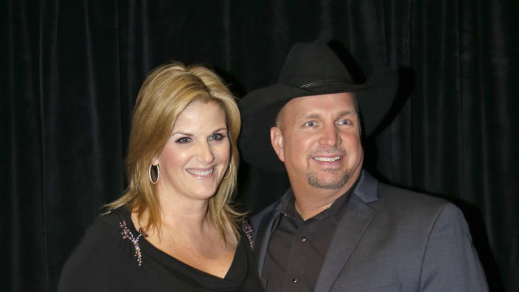 Garth Brooks, right, and Trisha Yearwood arrive for the Nashville Songwriters Hall of Fame inductions on Sunday, Oct. 7, 2012, in Nashville, Tenn. (AP Photo/Mark Humphrey)