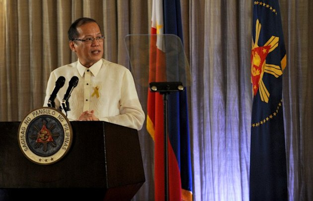 Philippine President Benigno Aquino gives an address at the Malacanang Palace in Manila on October 15, 2012. Aquino on Wednesday signed into law a 2.005 trillion-peso ($49 billion) budget for 2013, vowing to use higher taxes on tobacco and alcohol to boost programmes to reduce poverty
