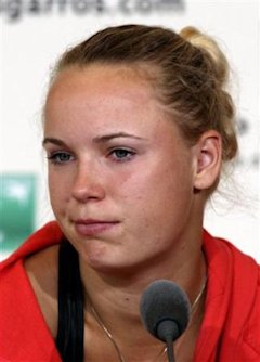 Denmark's Caroline Wozniacki reacts during a press conference after losing to Slovakia's Daniela Hantuchova in a third round match of the French Open