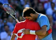 Argentina's Juan Martin del Potro congratulates Switzerland's Roger Federer after losing in the men's singles semifinal round match at the 2012 London Olympic Games at the All England Tennis Club in Wimbledon, southwest London, on August 3