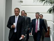 US House Speaker John Boehner (L) arrives at a meeting of Republican members of the House of Representatives on September 28, 2013 in Washington