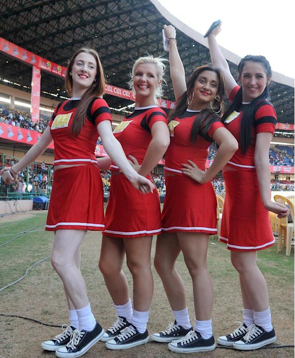 Cheer leader during a Celebrity Cricket League match between Telugu Warriors and Kerala Strikers at Chinnaswamy Stadium in Bangalore on Jan.26, 2014. (Photo: IANS)