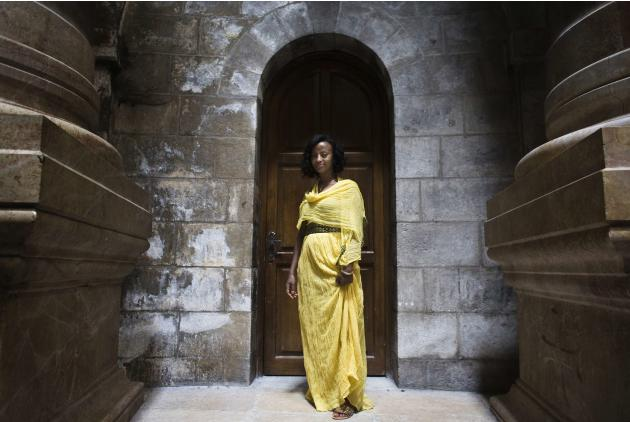 Masi, a tourist from Ethiopia, poses for a photograph in the Church of the Holy Sepulchre in Jerusalem's Old City
