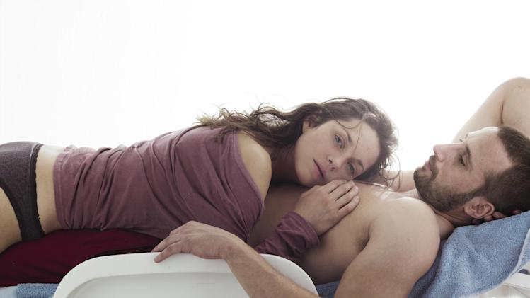 "This film image released by Sony Pictures Classics shows Marion Cotillard, left, and Matthias Schoenaerts  in a scene from ""Rust and Bone."" (AP Photo/Sony Pictures Classics)"
