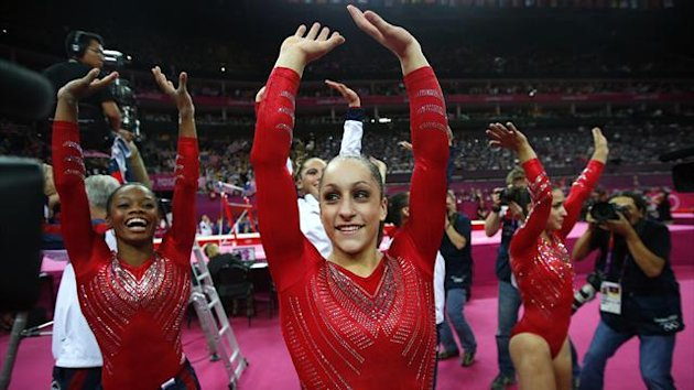 Jordyn Wieber (C) of the U.S. and team mate Gabrielle Douglas (L) celebrate after the women's gymnastics team final in the North Greenwich Arena at the London 2012 Olympic Games (Reuters)