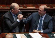 Italy's Prime Minister Enrico Letta (L) is congratulated by Interior Minister Angelino Alfano (R) after asking for a possible call for a confidence vote immediately at the Lower house of the parliament in Rome, October 2, 2013. REUTERS/Remo Casilli