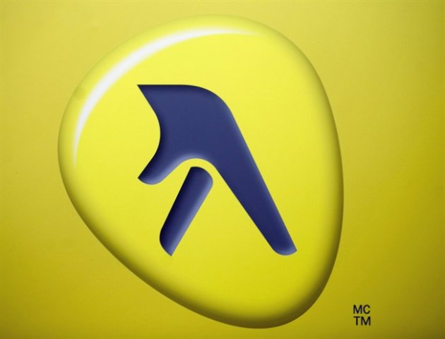 The Yellow Media Inc. logo is shown at the company's quarterly results meeting in Montreal, Thursday, May 6, 2010. The maker of the once ubiquitous telephone directory is beginning to drop home delivery in some Canadian communities. THE CANADIAN PRESS/Graham Hughes
