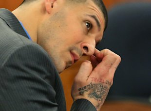 Aaron Hernandez wipes his face as he listens to the judge instruct the jury during his murder trial. (AP)