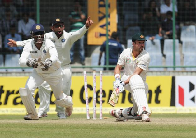 Phillip Hughes of Australia bold out by Ishant Sharma of India during the 4th test match of Border Gavaskar Trophy, at Ferozeshah Kotla Stadium in Delhi on March 22, 2013. P D Photo by P S Kanwar