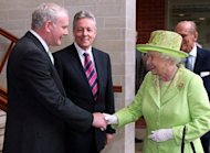 Britain's Queen Elizabeth II shakes hands with Northern Ireland Deputy First Minister Martin McGuinness at the Lyric Theatre in Belfast, in a landmark moment in the Northern Ireland peace process, Buckingham Palace said