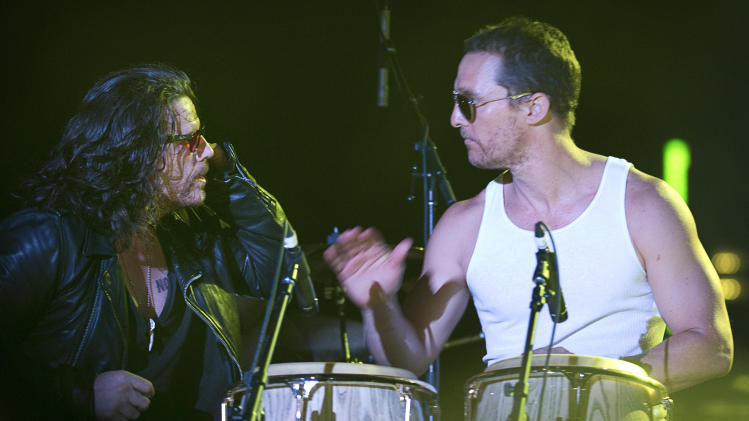 Actor Matthew McConaughey, right, plays the bongos with Ian Astbury of The Cult during The Cult's performance at South by Southwest (SXSW) on Saturday March 17, 2012.  (AP Photo/Austin American-Statesman, Jay Janner)