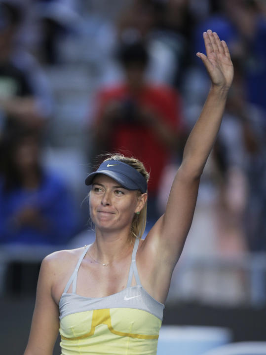 Russia's Maria Sharapova waves to the crowd after defeating Japan's Misaki Doi during their second round match at the Australian Open tennis championship in Melbourne, Australia, Wednesday, Jan. 16, 2