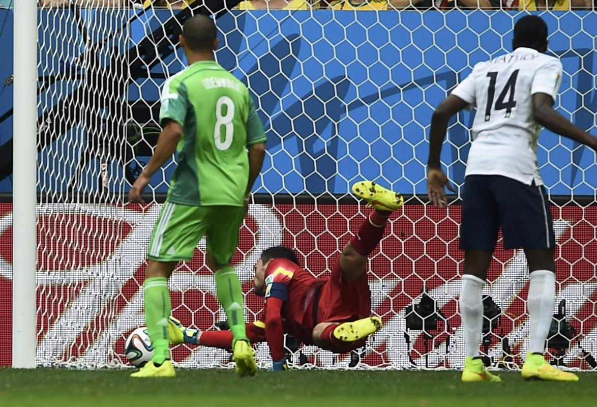 Nigeria's Emenike shoots to score a goal past France's goalkeeper Lloris during their 2014 World Cup round of 16 game at the Brasilia national...