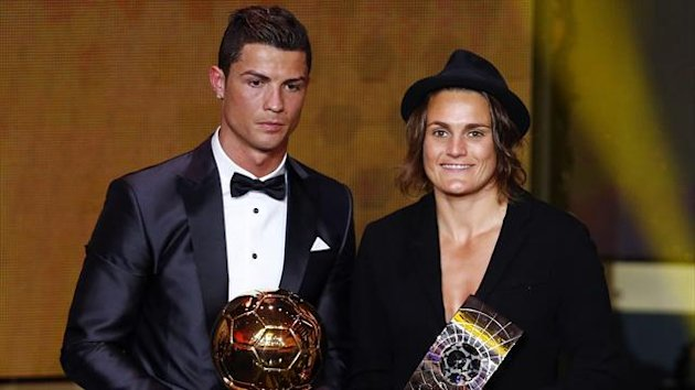 FIFA Ballon d'Or 2013 winner Cristiano Ronaldo (L) of Portugal poses with Women's World Player of the Year winner Nadine Angerer of Germany during the FIFA Ballon d'Or 2013 soccer awards ceremony in Zurich January 13, 2014 (Reuters)