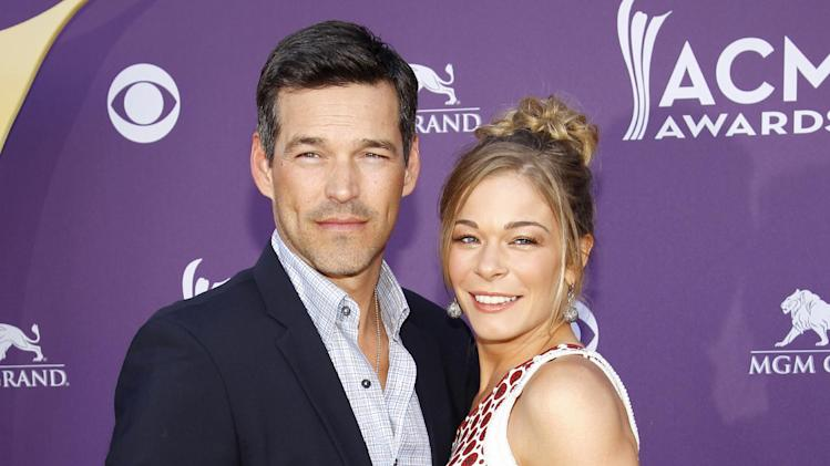 "FILE - This April 1, 2012 file photo shows country singer LeAnn Rimes, right, and her husband Eddie Cibrian at the 47th Annual Academy of Country Music Awards in Las Vegas. The couple will have a six-episode series on VH1, scheduled to debut either later this year or in early 2014 and tentatively called ""LeAnn & Eddie."" (AP Photo/Isaac Brekken, File)"