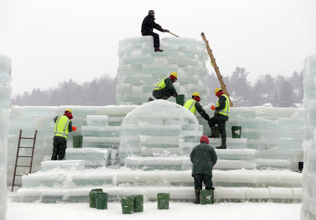 Volunteer Jeff Branch, top, and inmates from the Moriah Shock Incarceration Correctional Facility, work on the Saranac Lake Winter Carnival ice palace on Monday, Jan. 28, 2013, in Saranac Lake, N.Y. (