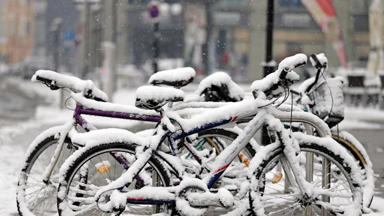 Bicycles are covered with snow in Leipzig, eastern Germany, Good Friday March 29, 2013. Weather forecassts predict a snowy and cold Easter weekend.  (AP Photo/dpa,Jan Woitas)