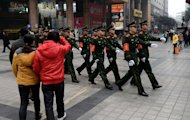 Chinese paramilitary police march through the shopping area of Chongqing, February 3, 2013. A year after Chongqing's police chief set off China's biggest scandal in decades, the megacity has seen revelations of torture, corruption and rights abuses, but little revolutionary change