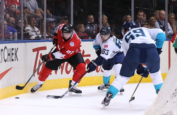 TORONTO, ON - SEPTEMBER 21: Sidney Crosby #87 of Team Canada stickhandles the puck with pressure from Mats Zuccarello #63 of Team Europe during the World Cup of Hockey 2016 at Air Canada Centre on September 21, 2016 in Toronto, Ontario, Canada. (Photo by Andre Ringuette/World Cup of Hockey via Getty Images)