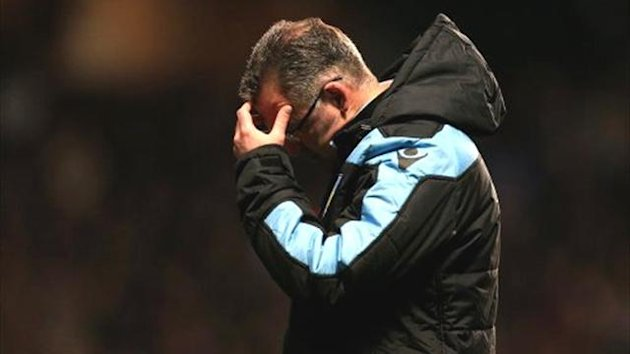 Aston Villa boss Paul Lambert looks down in despair (PA Sport)