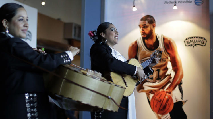 A mariachi band plays for fans as they enter AT&T arena fore Game 2 of the opening-round NBA basketball playoff series between the San Antonio Spurs and the Dallas Mavericks, Wednesday, April 23, 2014, in San Antonio