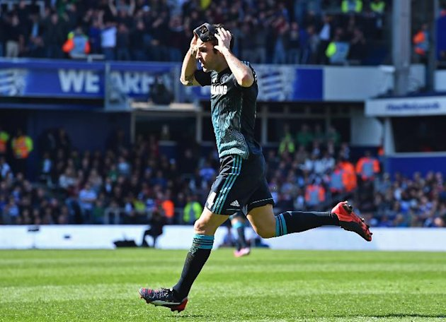 Chelsea's midfielder Cesc Fabregas celebrates after scoring a goal during the English Premier League football match in London on April 12, 2015