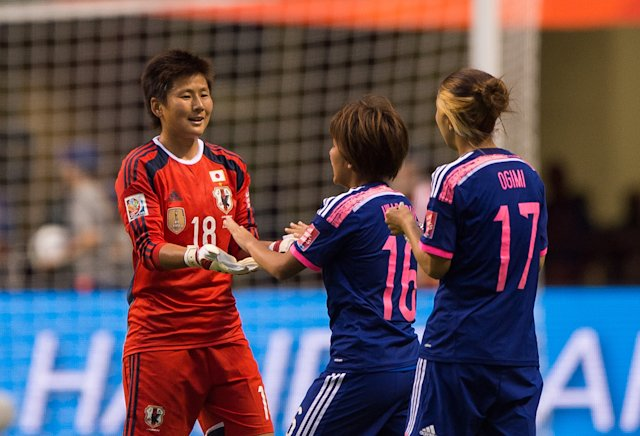 VANCOUVER, BC - JUNE 23: Goalkeeper Ayumi Kaihori #18 of Japana celebrates with Mana Iwabuchi #16 and Yuki Ogimi #17 after defeating the Netherlands 2-1 during the FIFA Women's World Cup Canada 2015 Round of 16 match between the Netherlands and Japan June, 23, 2015 at BC Place Stadium in Vancouver, British Columbia, Canada.  (Photo by Rich Lam/Getty Images)