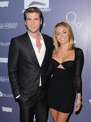 Liam Hemsworth and Miley Cyrus (in a revealing top!) step out at Australians In Film Awards & Benefit Dinner at InterContinental Hotel in Century City, Calif. on June 27, 2012 -- Getty Images