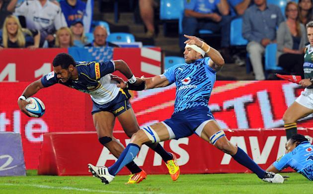 Australian ACT Brumbies' winger Henry Speight (L) scores a try during the Super 15 Rugby Match between Northern Bulls and Canterbury Crusaders at Loftus Versfeld stadium in Pretoria, on April 21, 2012