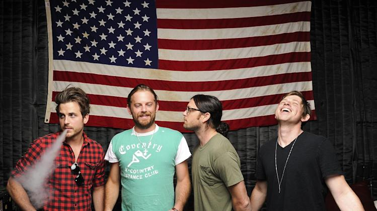 "This Sept. 5, 2013 photo shows members of Kings of Leon, from left, Jared Followill, Caleb Followill, Nathan Followill and Matthew Followill posing in Nashville, Tenn. The band's latest album, ""Mechanical Bull,"" will be released on Tuesday, Sept. 24. (Photo by Donn Jones/Invision/AP)"
