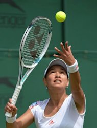 Japan's Kimiko Date-Krumm serves during her first round women's singles match against Ukraine's Kateryna Bondarenko on day three of the 2012 Wimbledon Championships tennis tournament at the All England Tennis Club in Wimbledon, southwest London