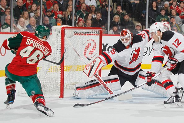ST. PAUL, MN - JANUARY 17: Jared Spurgeon #46 of the Minnesota Wild scores a goal against Ben Lovejoy #12 and goalie Cory Schneider #35 of the New Jersey Devils during the game on January 17, 2017 at the Xcel Energy Center in St. Paul, Minnesota. (Photo by Bruce Kluckhohn/NHLI via Getty Images)
