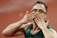 South Africa's Oscar Pistorius celebrates after winning the gold medal in the athletics men's 400M T44 finals at the Beijing 2008 Paralympic Games September 16, 2008. REUTERS/Claro Cortes IV (CHINA) - RTR21Y1N