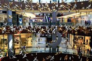 A file picture from 2010 of the Dubai Mall. In a city where shopping and spending is a favourite pastime, Dubai's malls will open round-the-clock for three consecutive weekends from Thursday as part of the upcoming Muslim holiday