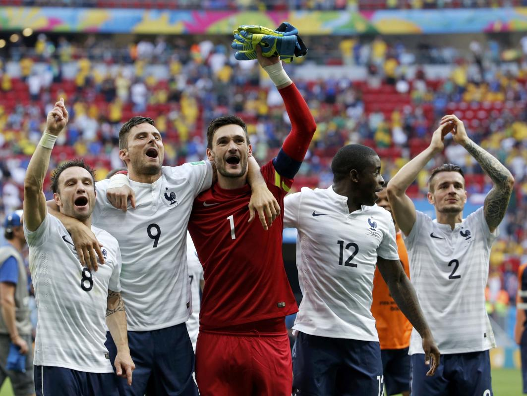 France's players celebrate after winning their 2014 World Cup round of 16 game against Nigeria at the Brasilia national stadium in Brasilia