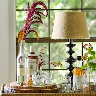 Repurpose empty bottles as vases