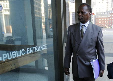 Onyango Obama arrives for a hearing at a federal immigration court in Boston