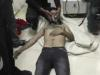 In this Friday, April 11, 2014 image made from amateur video provided by the Shams News Network, a loosely organized anti-Assad group based in and out of Syria that claim not to have any connection to Syrian opposition parties or any other states, and which is consistent with independent AP reporting, a man lies on the floor with an oxygen mask at a hospital room in Kfar Zeita, some 200 kilometers (125 miles) north of Damascus, Syria. Syrian government media and rebel forces said Saturday, April 12, 2014 that poison gas had been used in the village, on Friday injuring scores of people, while blaming each other for the attack. (AP Photo/Shams News Network)