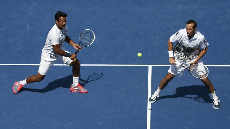 Paes of India and Stepanek of the Czech Republic return to Bob and Mike Bryan of the U.S. in their men's doubles match at the U.S. Open tennis championships in New York