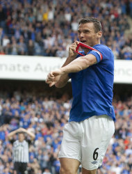 Rangers' Lee McCulloch celebrates his goal against Elgin City by kissing the captain's arm band