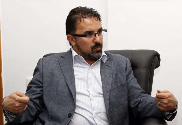 Senior lawmaker Mohammed Ali Abdallah, head of the parliament's budget committee, speaks during an interview with Reuters in Tripoli
