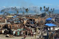 Devastation in the town of Baganga. Mindanao civil defence chief Benito Ramos said that -- unlike in the rest of the majority-Catholic Philippines -- there would be no Christmas parties in the storm hit towns, just the burials of bodies.