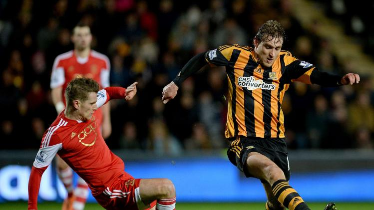 Southampton's Davis challenges Hull City's Jelavic during their English Premier League soccer match at the KC Stadium in Hull