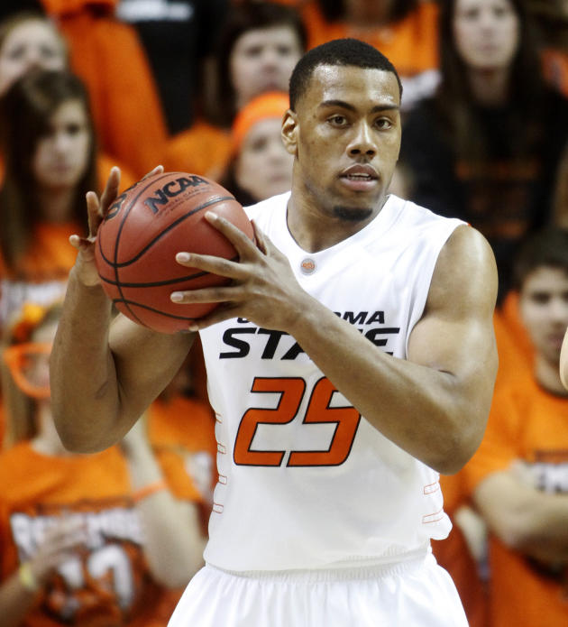 Court tosses ex-Oklahoma State player's conviction