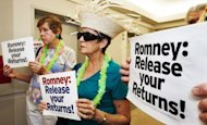 Protesters in July 2012 at Mitt Romney's campaign office in Arlington, Virginia, calls for the Republican presidential nominee to release more of his tax returns. Romney paid $1.9 million in taxes on income of $13.6 million in 2011, an effective rate of 14.1 percent, his campaign said, citing returns filed