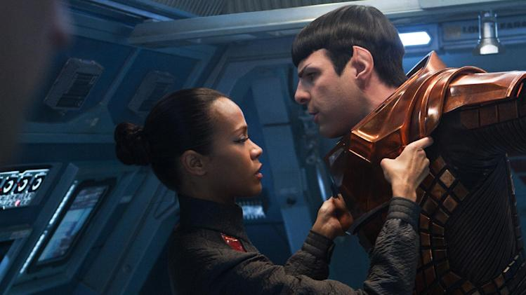 "This undated publicity film image released by Paramount Pictures shows, Zoe Saldana, left, as Uhura and Zachary Quinto as Spock in a scene in the movie, ""Star Trek Into Darkness,"" from Paramount Pictures and Skydance Productions. (AP Photo/Paramount Pictures, Zade Rosenthal)"