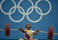 Colombia's Jackelina Heredia Cuesta competes in the weightlifting women's 58kg group A event at The Excel Centre in London on July 30, 2012, during the London 2012 Olympic Games. Xueying set a new world record. AFP PHOTO / YURI CORTEZ